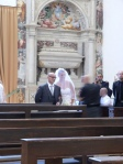 Chiara and her father walking down the aisle